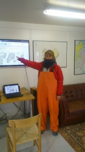 Pointing out the hurricane in the Reykjavik harbourmaster's office.